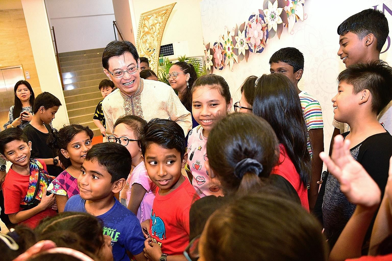 Deputy Prime Minister Heng Swee Keat with children from Sunlove Home during the largest interfaith leaders' Deepavali celebration at PGP Hall in Serangoon Road yesterday. Mr Heng, who is also Finance Minister, joined 150 guests from 10 different fait