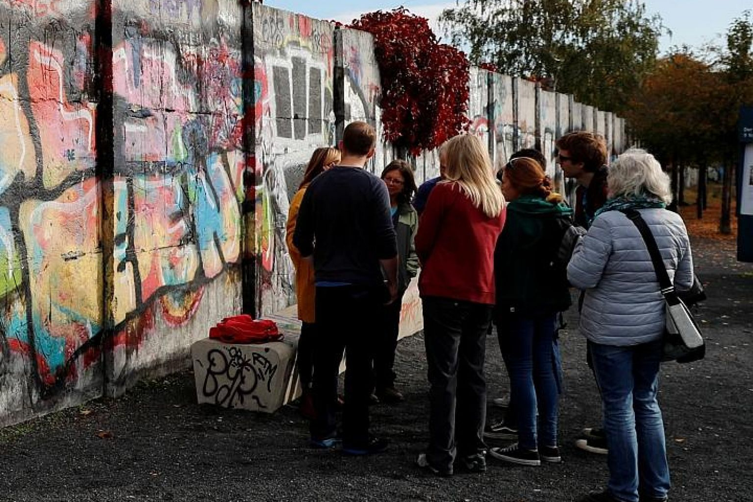 Remains of the Berlin Wall at the former Bornholmer Strasse border crossing. Frustration and nostalgia for a rose-tinted past are fuelling the rise in support for parties of the far left and right today, says the writer.