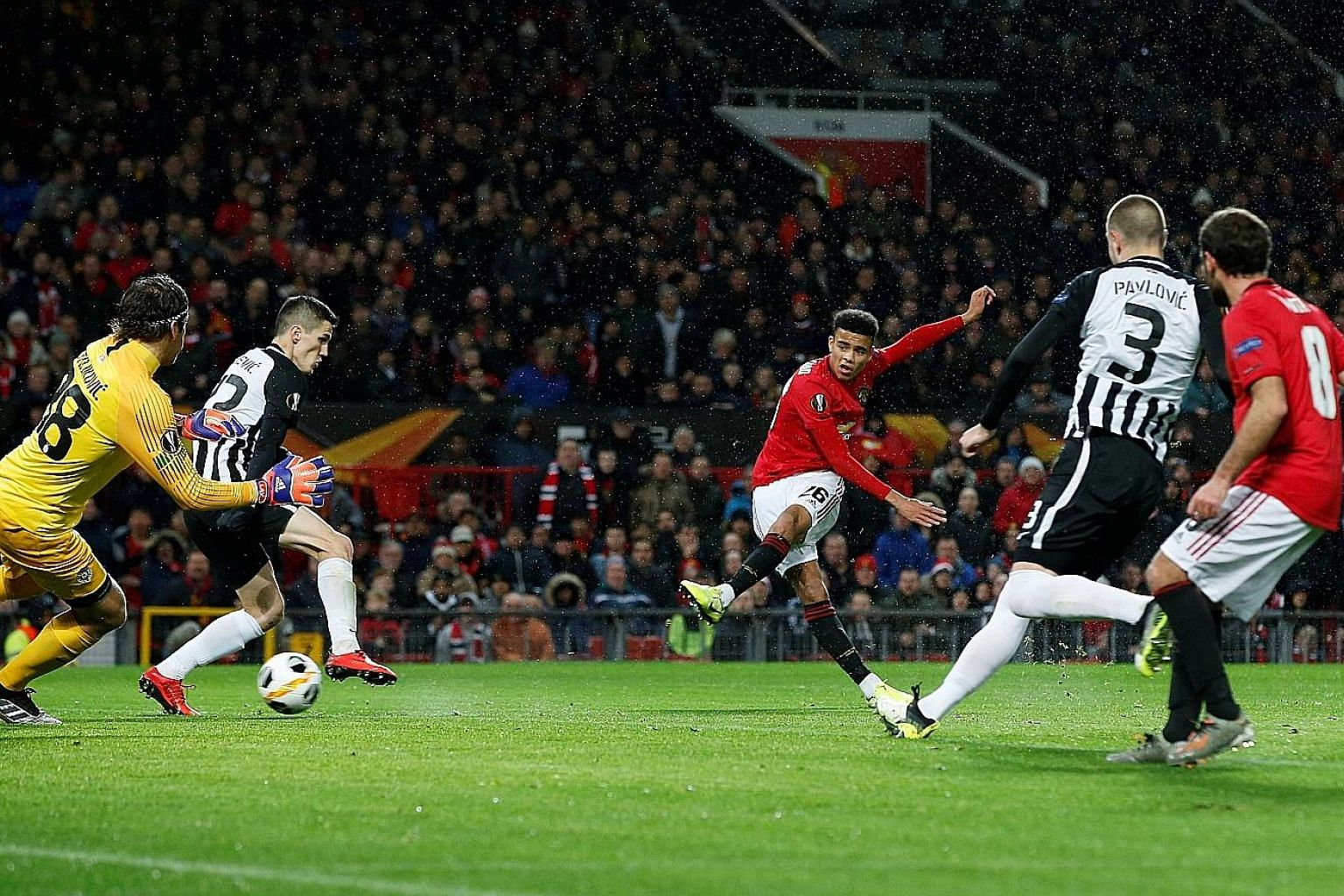 Manchester United's 18-year-old striker Mason Greenwood scoring the first goal of the night in the 3-0 Europa League win over Partizan Belgrade. The victory ensured that United have made it through to the knockout stage of the competition.