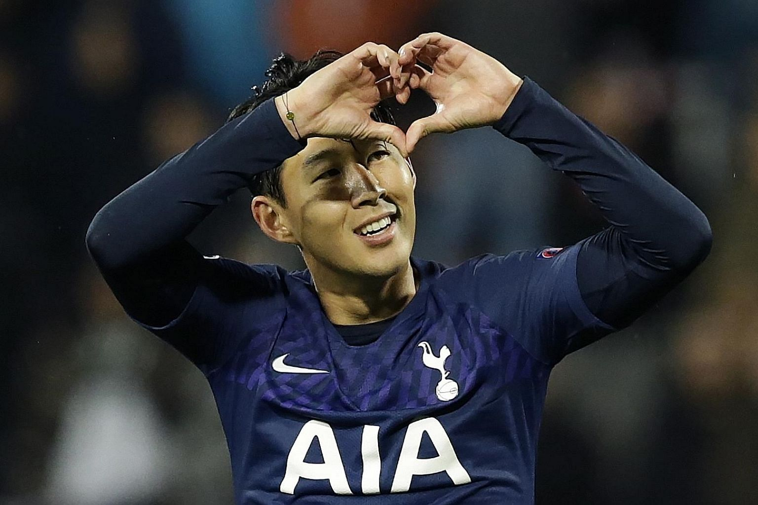 Son Heung-min gesturing to fans after scoring against Red Star in a 4-0 win. He is picking himself up after his role in Andre Gomes' injury. PHOTO: EPA-EFE