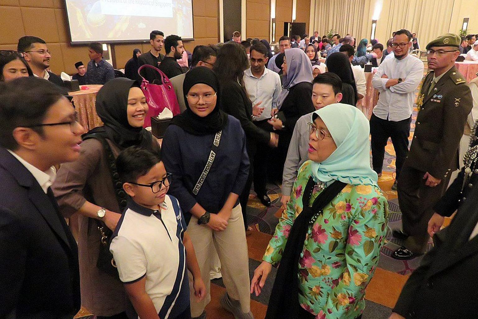 President Halimah Yacob with the Singaporean community in Saudi Arabia at a reception in Jeddah on Thursday. ST PHOTO: FABIAN KOH