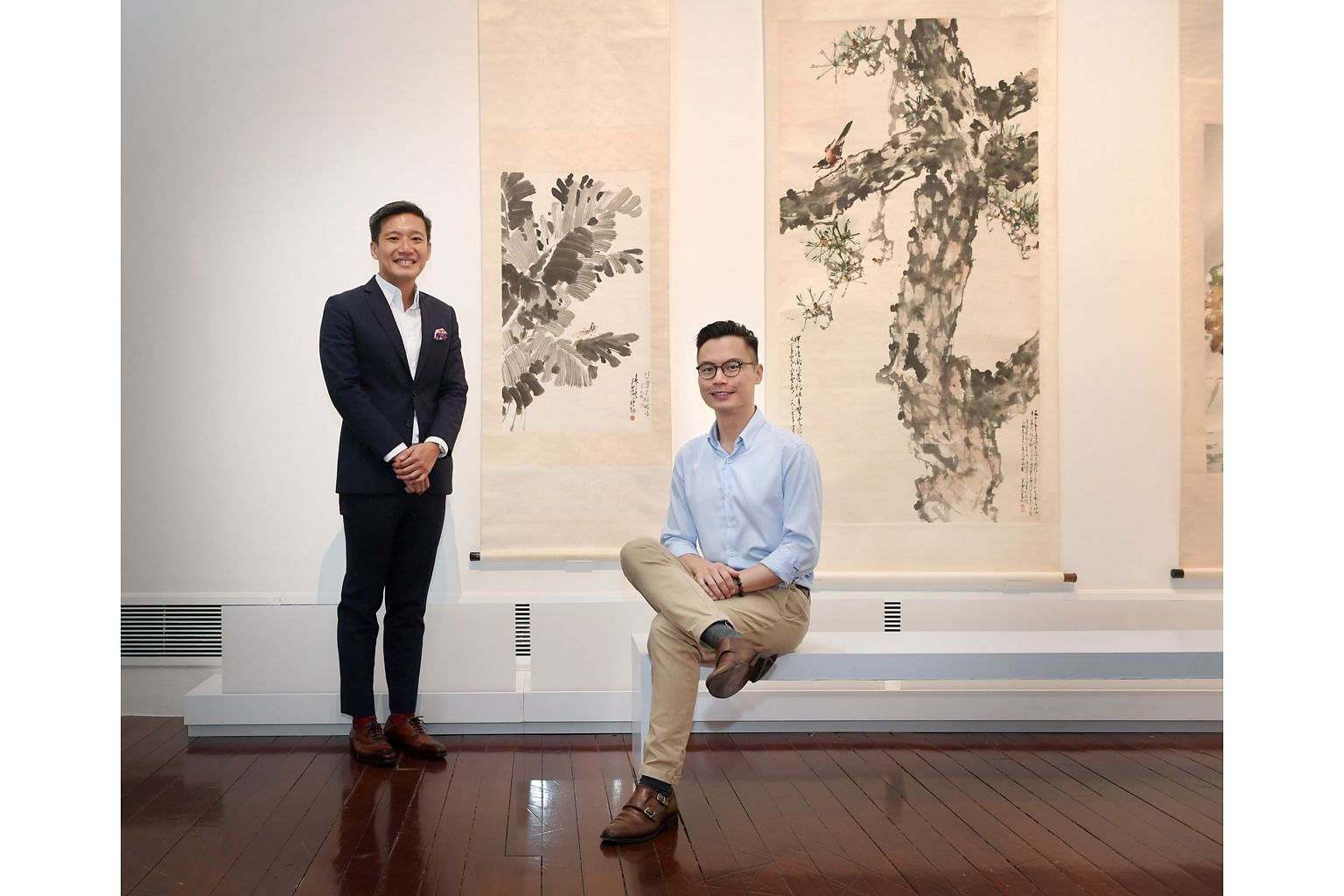 Asian Civilisations Museum director Kennie Ting (left) with Mr Conan Cheong, curator of the exhibition, Living With Ink: The Collection Of Dr Tan Tsze Chor.