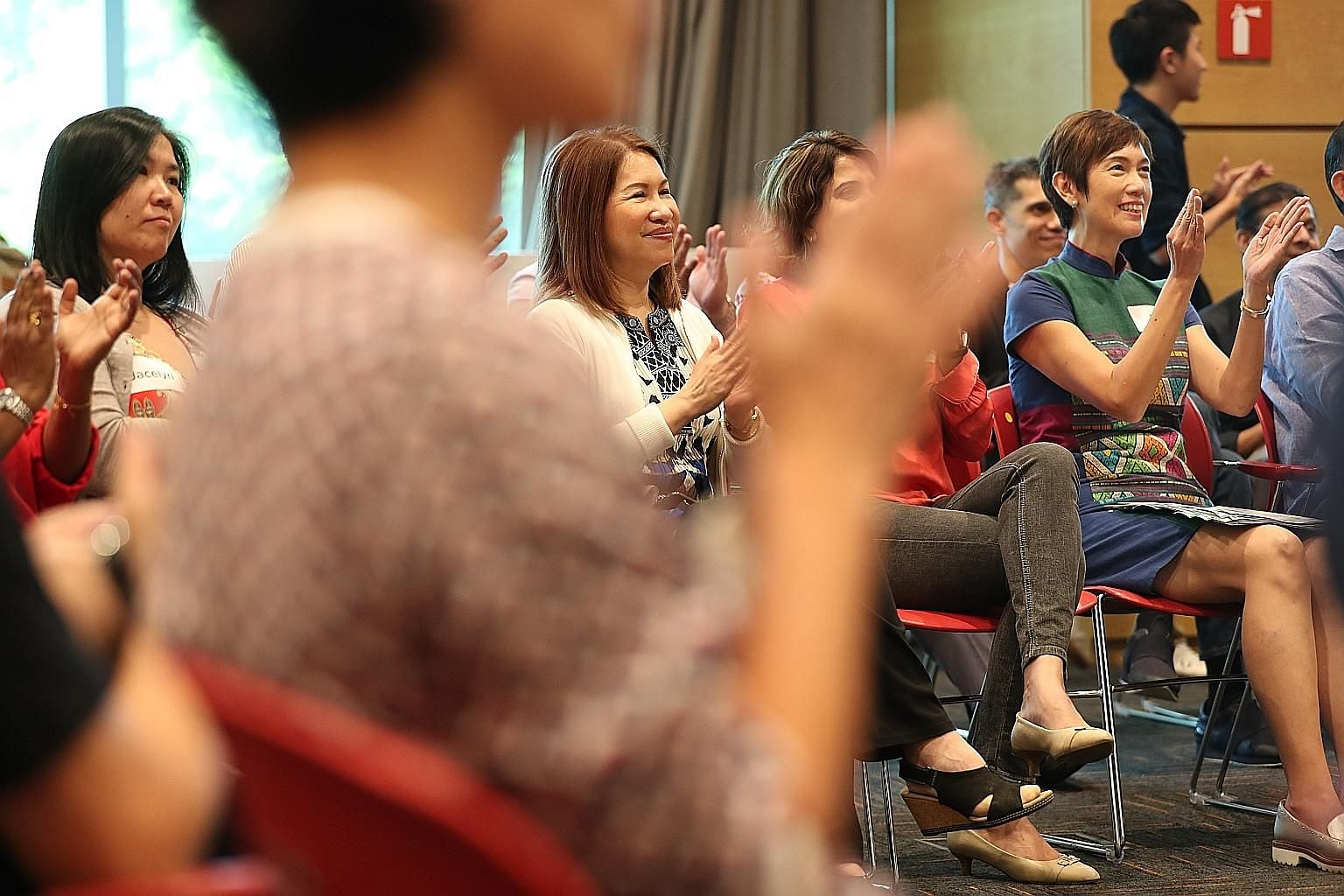 Manpower Minister Josephine Teo (at right) attending the Citizens' Panel on Work-Life Harmony's fourth and final session at the Lifelong Learning Institute yesterday.