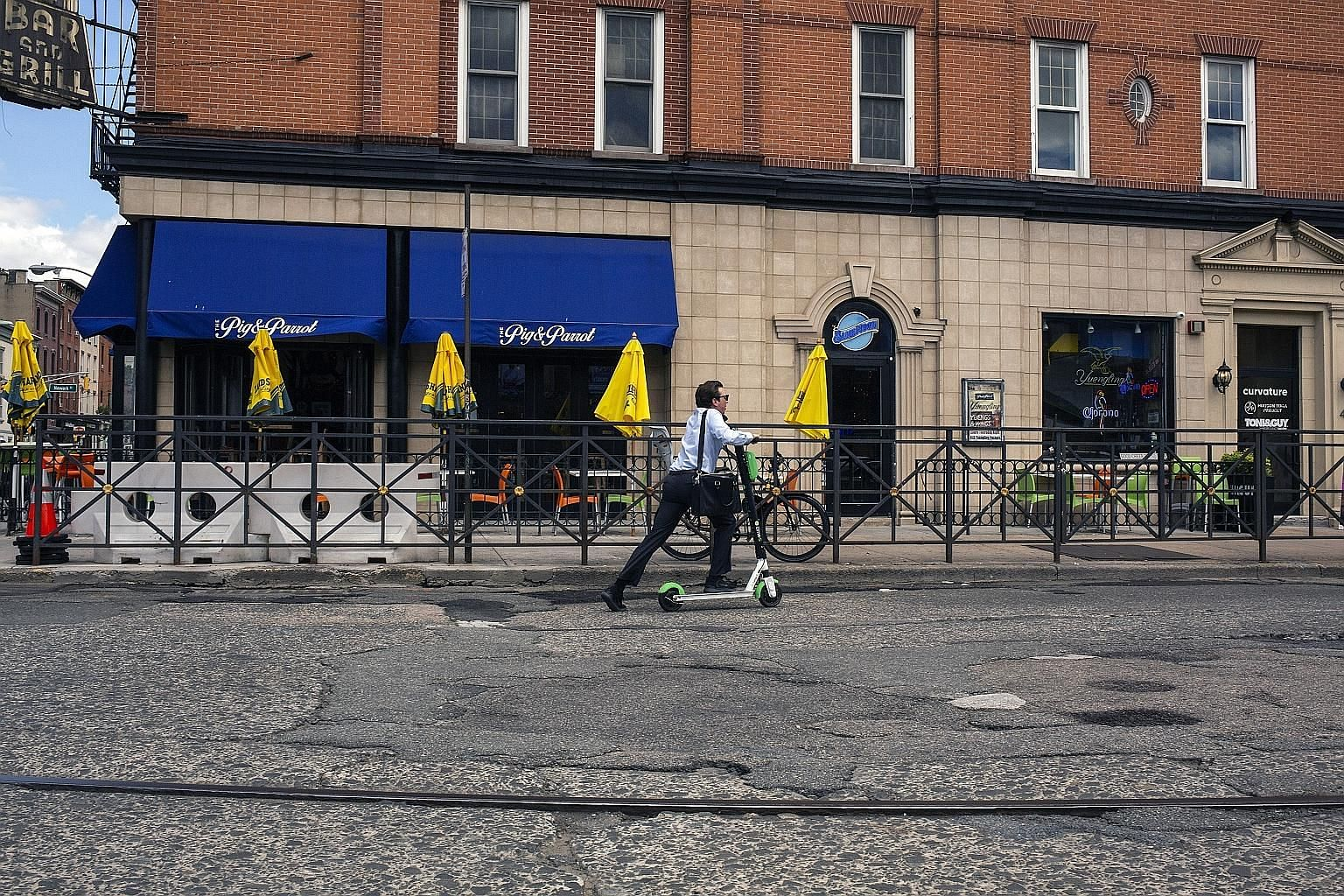 A man riding a scooter in Hoboken, New Jersey. The city had approved a six-month pilot programme with two e-scooter providers in May, but cancelled a contract with one. The pilot is due to end on Nov 20.