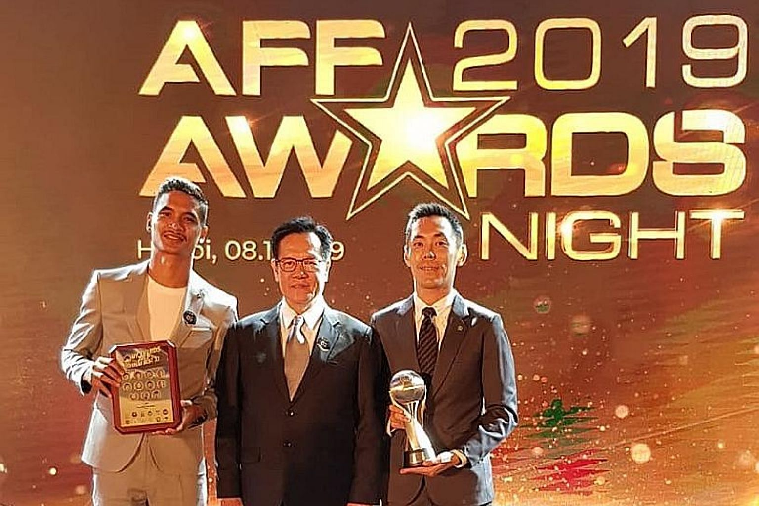 Safuwan Baharudin (left) and Assistant Referee of the Year Ronnie Koh with Football Association of Singapore president Lim Kia Tong (centre) at the Asean Football Federation Awards in Hanoi on Friday. The defender is the fifth Singaporean to be chosen amo