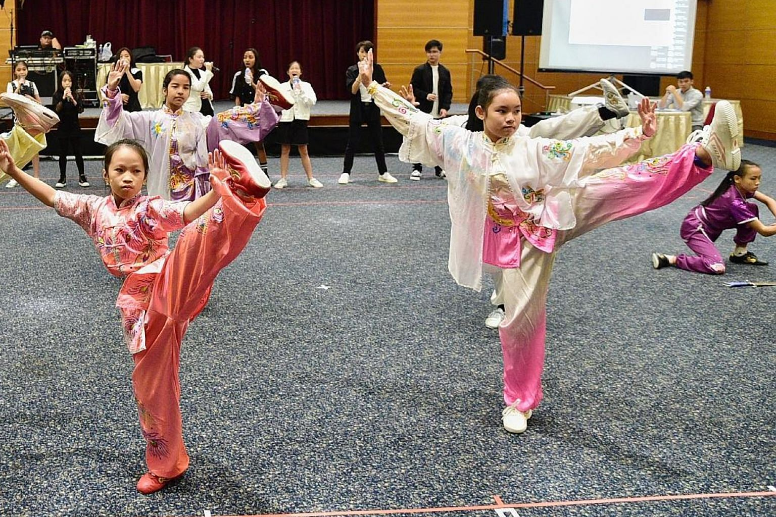 These children practising wushu moves were among over 100 children at Singapore Press Holdings' News Centre last Saturday for a rehearsal of charity concert ChildAid 2019. The Pavilion@Far East Square and Singapore Chinese Cultural Centre are providi