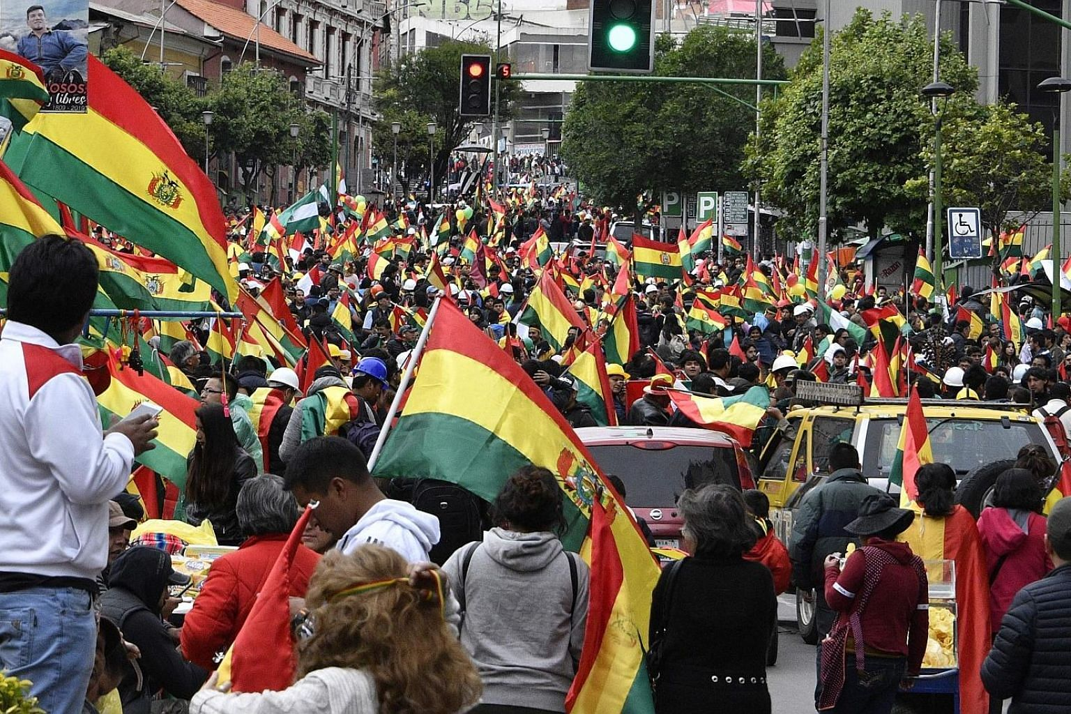 Mr Evo Morales said on Sunday he would step down to ease the violence that has gripped Bolivia since a disputed vote. Crowds taking to the streets of Bolivia's capital La Paz on Sunday to celebrate the resignation of President Evo Morales. But as nig