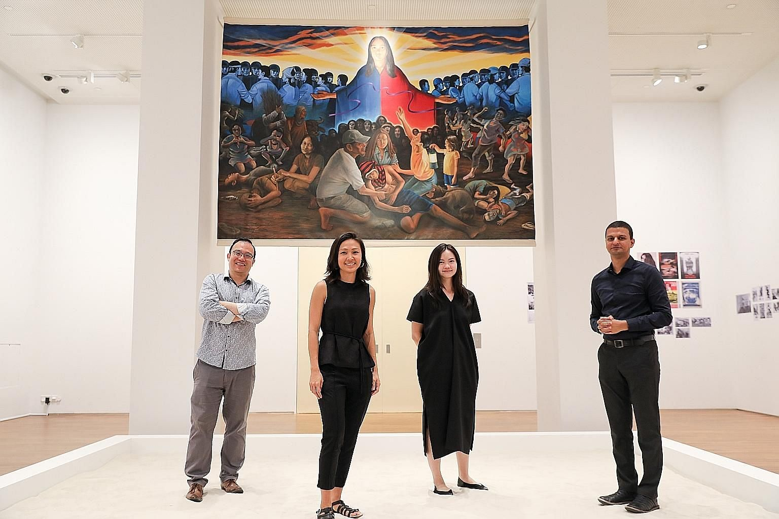 National Gallery Singapore curators (from far left) Seng Yu Jin, Joleen Loh, Cheng Jia Yun and Shabbir Hussain Mustafa standing in Step On The Sand And Make Footprints, a work by Filipino artist Raymundo Albano, which requires visitors to leave their