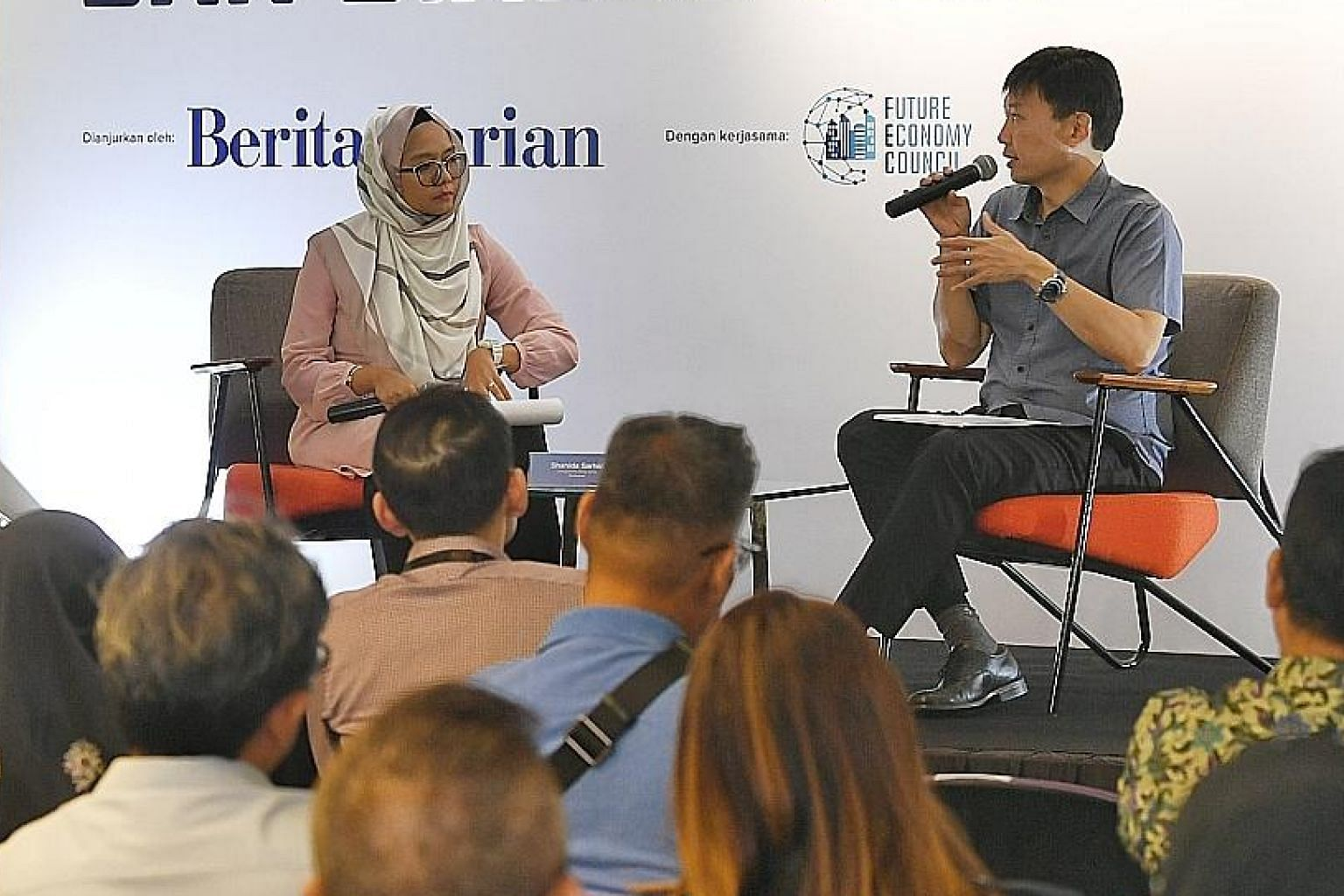Senior Minister of State for Trade and Industry Chee Hong Tat speaking at the Berita Harian Future Economy Seminar and Dialogue at Singapore Polytechnic yesterday. With him was Berita Harian correspondent Shahida Sarhid, who was the moderator.