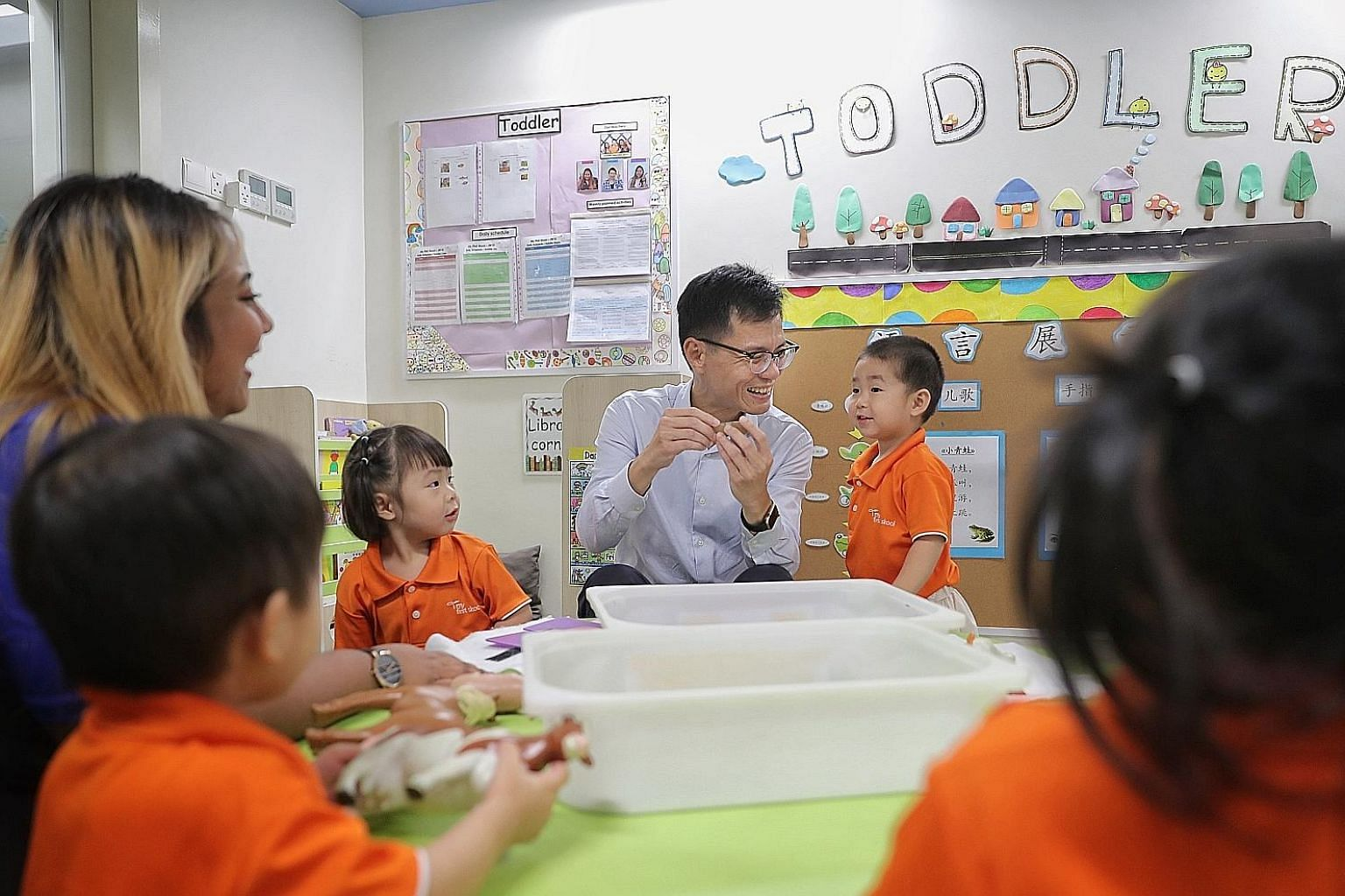 Mr Chan Tee Seng, chief executive of NTUC First Campus, and English teacher Nurul Salhida interacting with toddlers at My First Skool in Jurong West last month. NTUC First Campus, which runs My First Skool, will be spending $3 million in the next thr