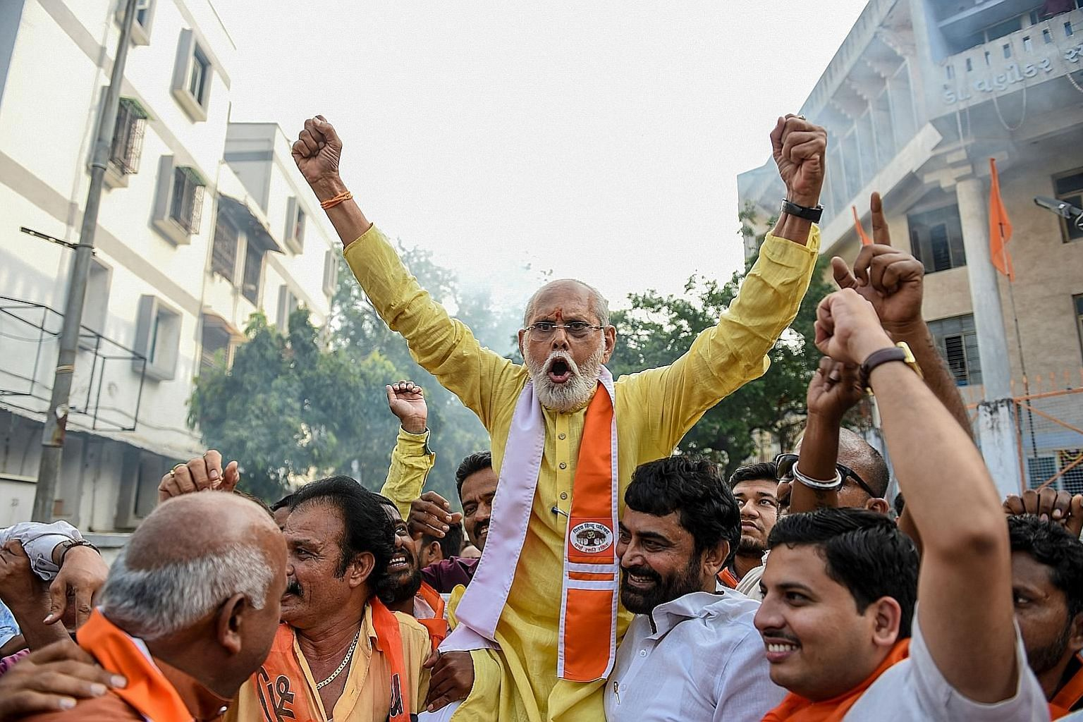 Supporters of the Vishwa Hindu Parishad militant organisation in Ahmedabad last Saturday, celebrating India's Supreme Court's decision to award control of a disputed religious site in Ayodhya to the Hindus.