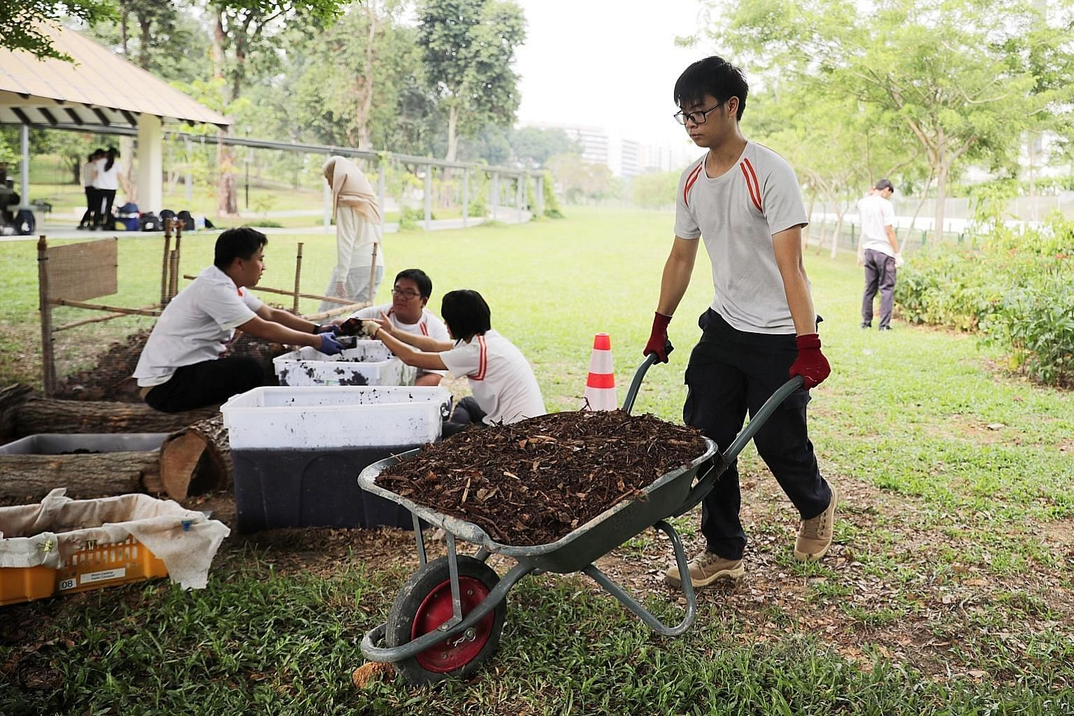 Students from ITE's Higher Nitec in Landscape Management and Design working at the Compositing and Vermiculture Zone at Bedok Town Park yesterday. ITE students also designed a garden with therapeutic features, deployed robotic mowers for turf managem