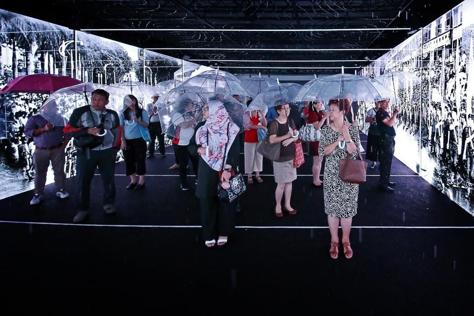 "Visitors to the ""rain enclosure"" of the bicentennial showcase at Fort Canning Centre being immersed in Singapore's history and achievements. The writer, as a member of the Pioneer Generation, remembers what life was like in the country's pre-Independ"