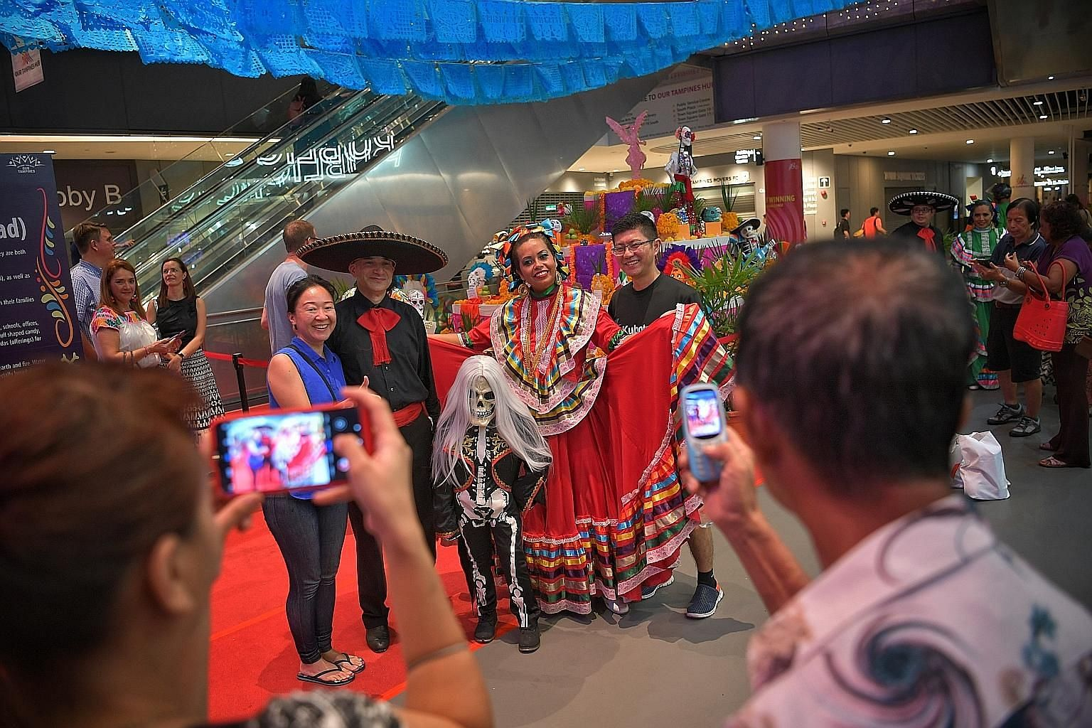 Costumed performers took Day of the Dead festivities into the heartland on Tuesday, with the launch of celebrations for the Mexican festival, Dia de Muertos, at Our Tampines Hub. Visitors were treated to food and musical performances, and viewed a ph