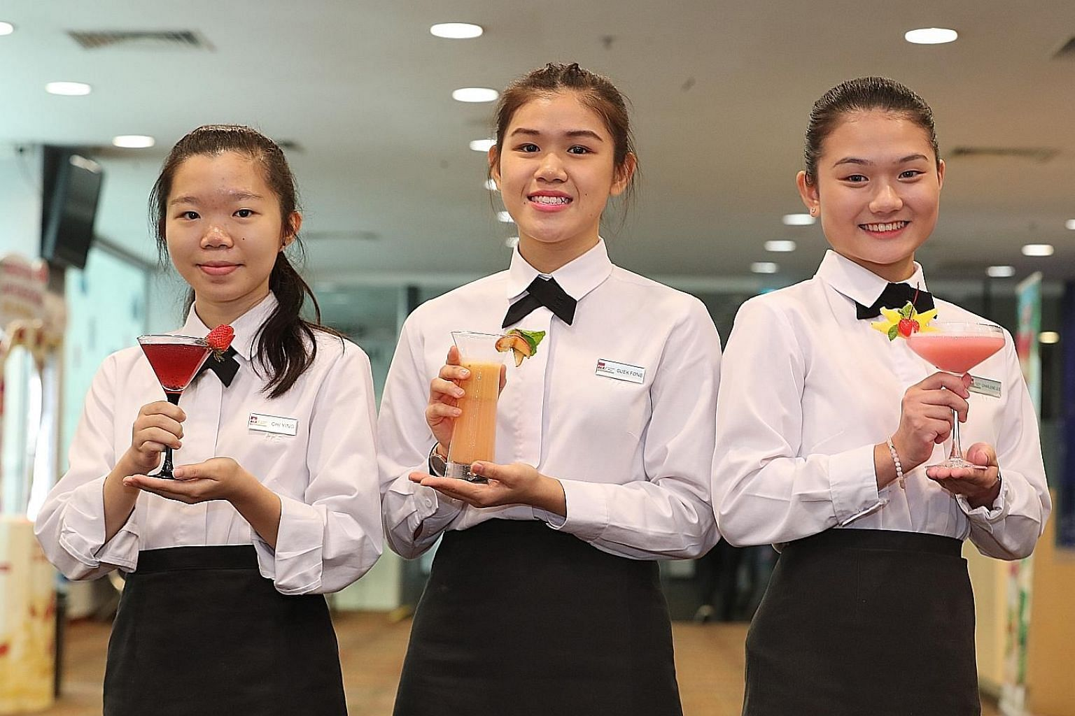 From left: First runner-up Ting Chi Ying with her drink Merry Berry, winner Chow Ying Shun with Call Me Peachy and second runner-up Lee Yan Xuan Charlene with Pink Guavadise. The trio yesterday topped this year's The Greatest Mix - F&N Drinks Creatio