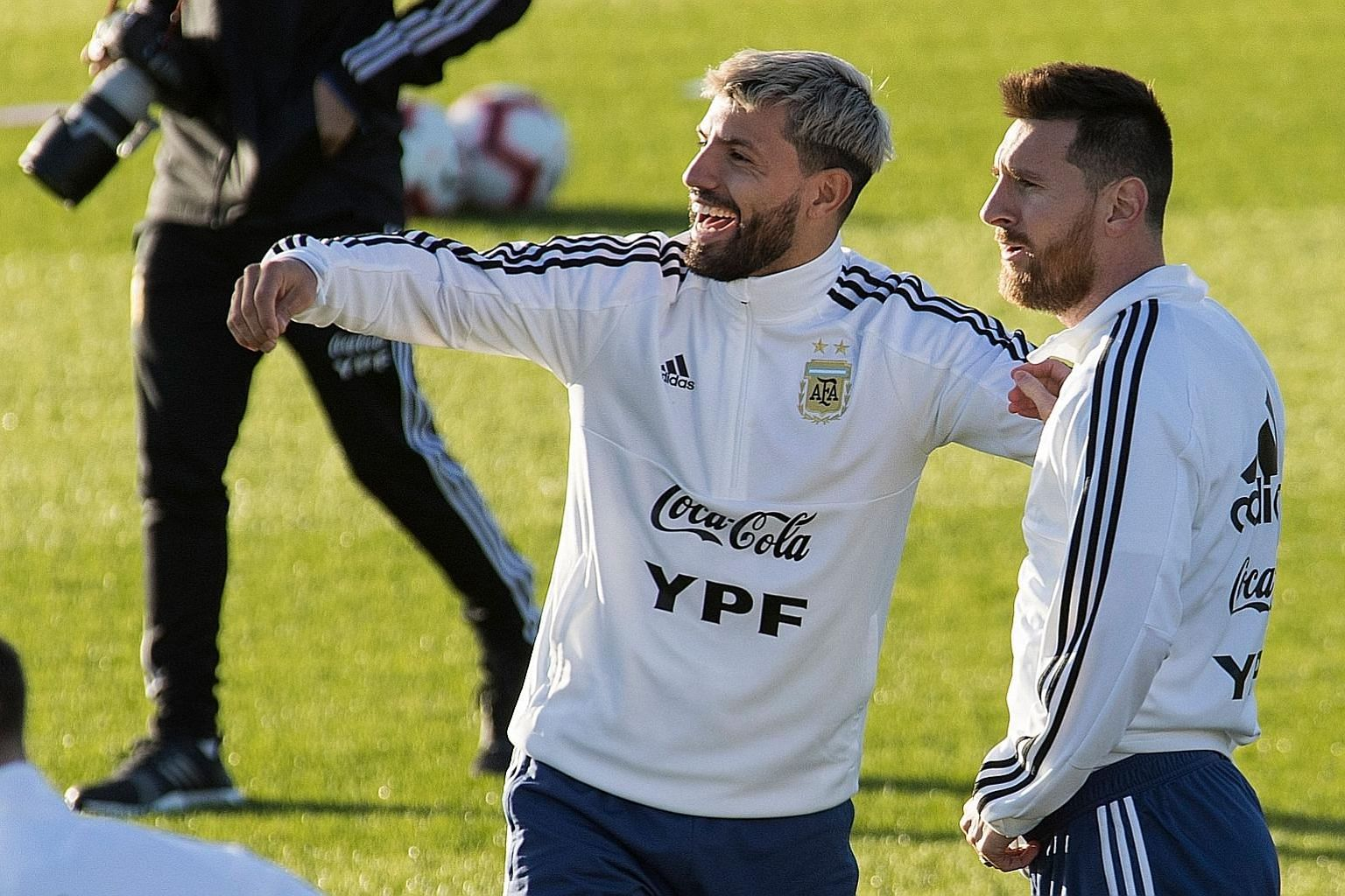 Argentina forwards Sergio Aguero and Lionel Messi sharing a laugh during a training session in Mallorca ahead of their friendly match against Brazil in Saudi Arabia today. Messi is back from a three-month ban for labelling the South American football