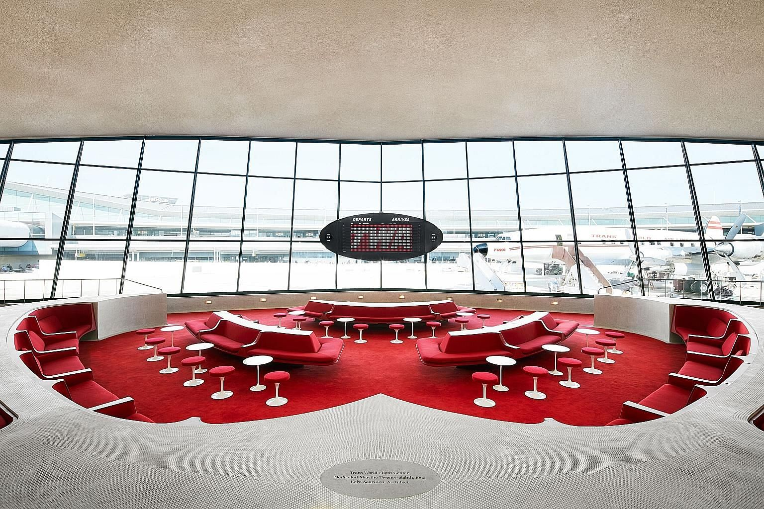 The interior of the TWA Hotel at John F. Kennedy International Airport features sweeping asymmetrical arches and lofty curved ceilings.