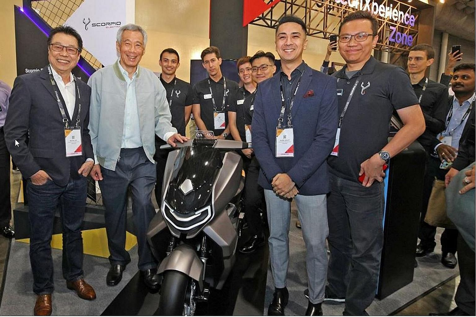 (From left) Mr Melvin Goh, chief executive of Scorpio Electric, Prime Minister Lee Hsien Loong, KTM Asia Managing Director Julian Legazpi and Acting Head of Operation at Scorpio Electric Muhammad Taureza posing with the scale model of the Scorpio EST