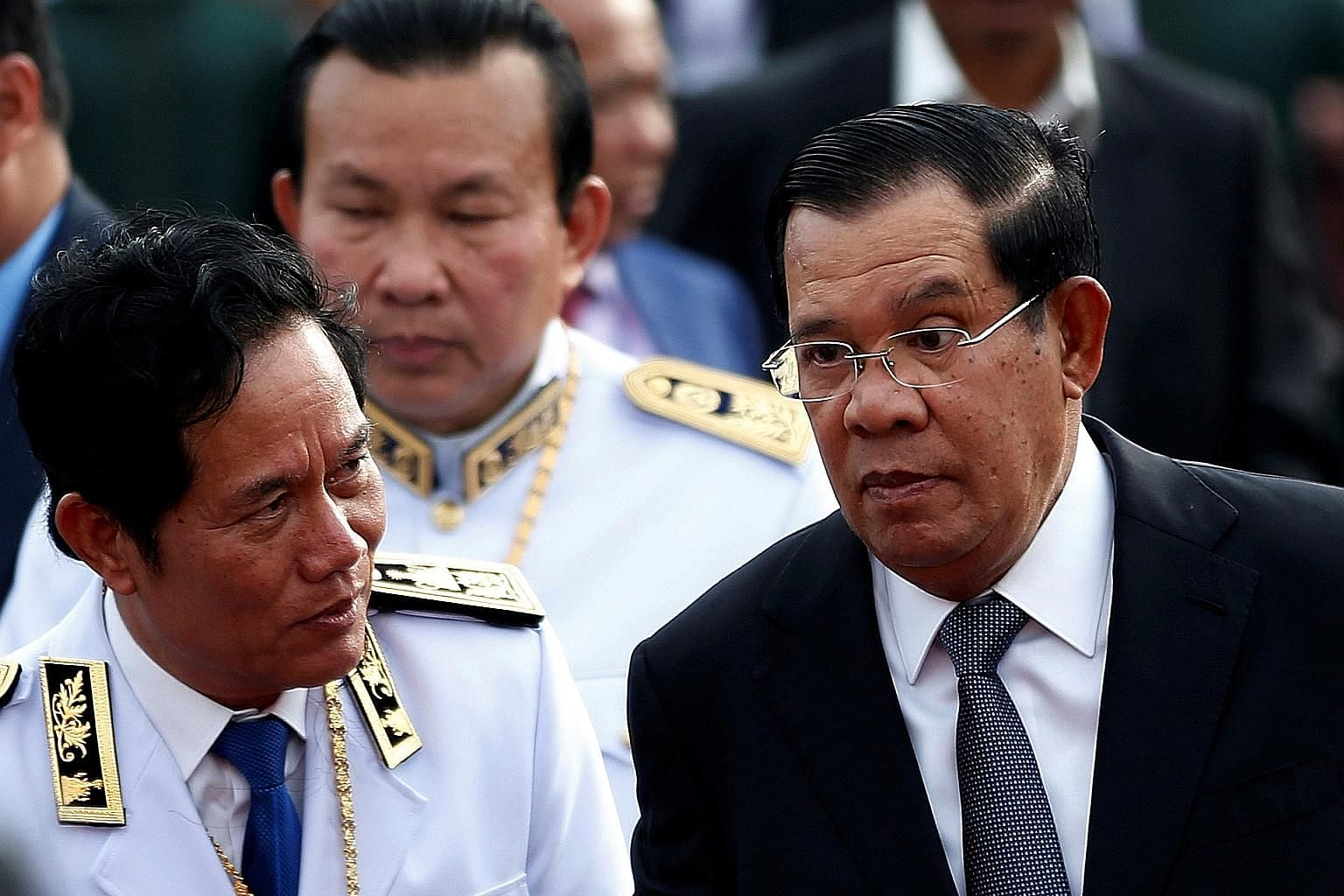 Cambodia's Prime Minister Hun Sen (right) attending a water festival in Phnom Penh. Asia's longest-serving leader has had to deal with discontent building among the country's 16 million people over a number of issues.