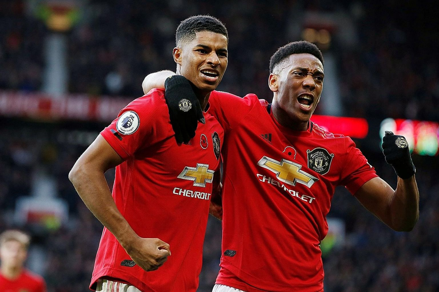 Marcus Rashford (left) celebrating scoring United's third goal in their 3-1 win over Brighton in the Premier League last Sunday with Anthony Martial.