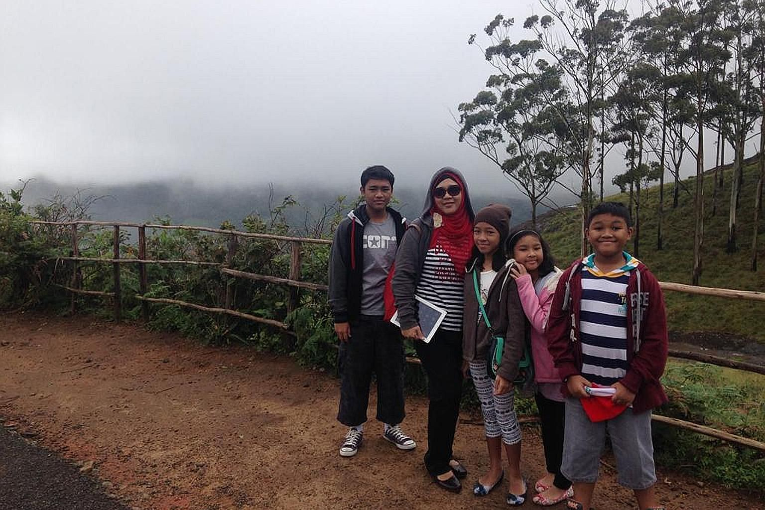Madam Nur Azah Ismail with her four children (from left): Izz Amsyar, Iffah Irdina, Ilya Insyirah and Irfan Afiq, in Munnar, a town in India's Kerala state. The family lived in Chennai for about two years because of their father's work posting.