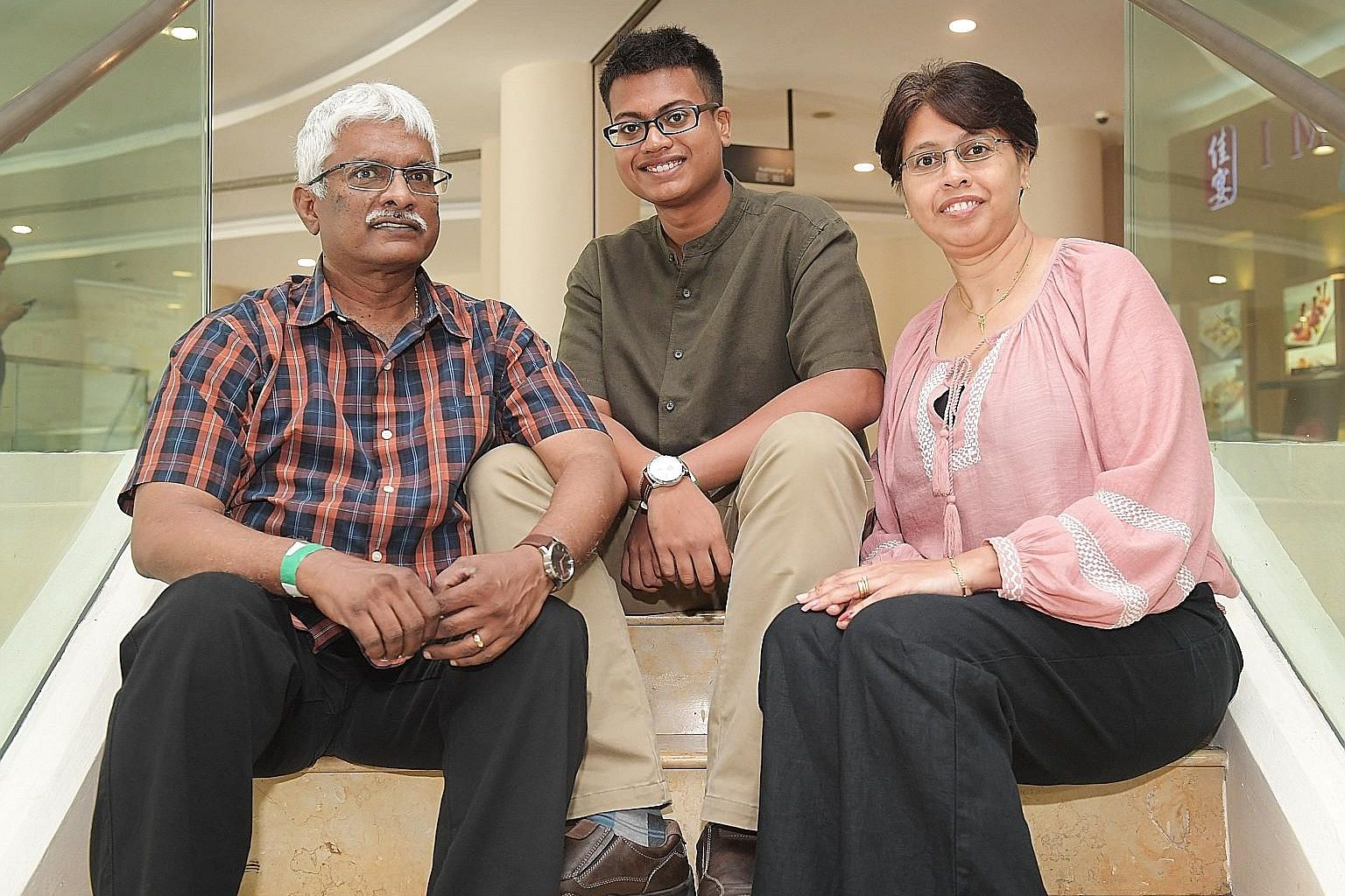 Mr Rajev Valayutham and his wife Lourdes Thomas Audrey, with their biological son Rajev Jarryll Deneshan. The family has cared for a total of 10 foster children in 15 years.