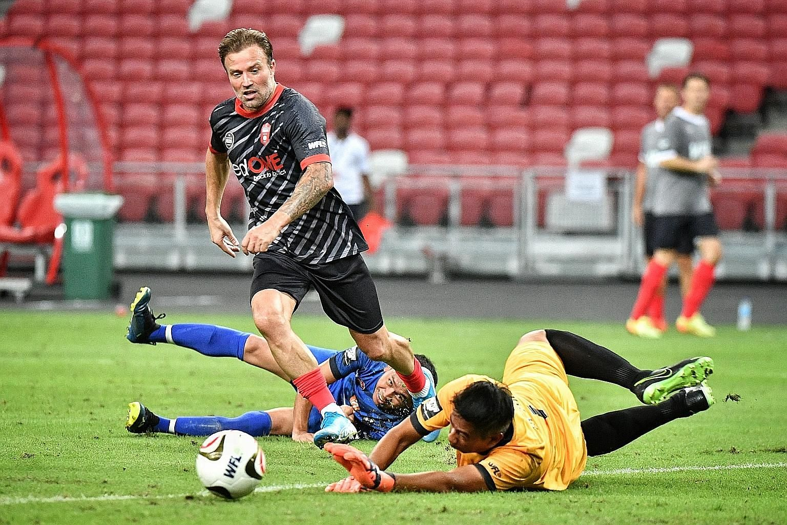Manchester Reds' Michael Gray beating the Singapore Reds' defence to score in their 2-0 win which set up the final against Liverpool Reds.