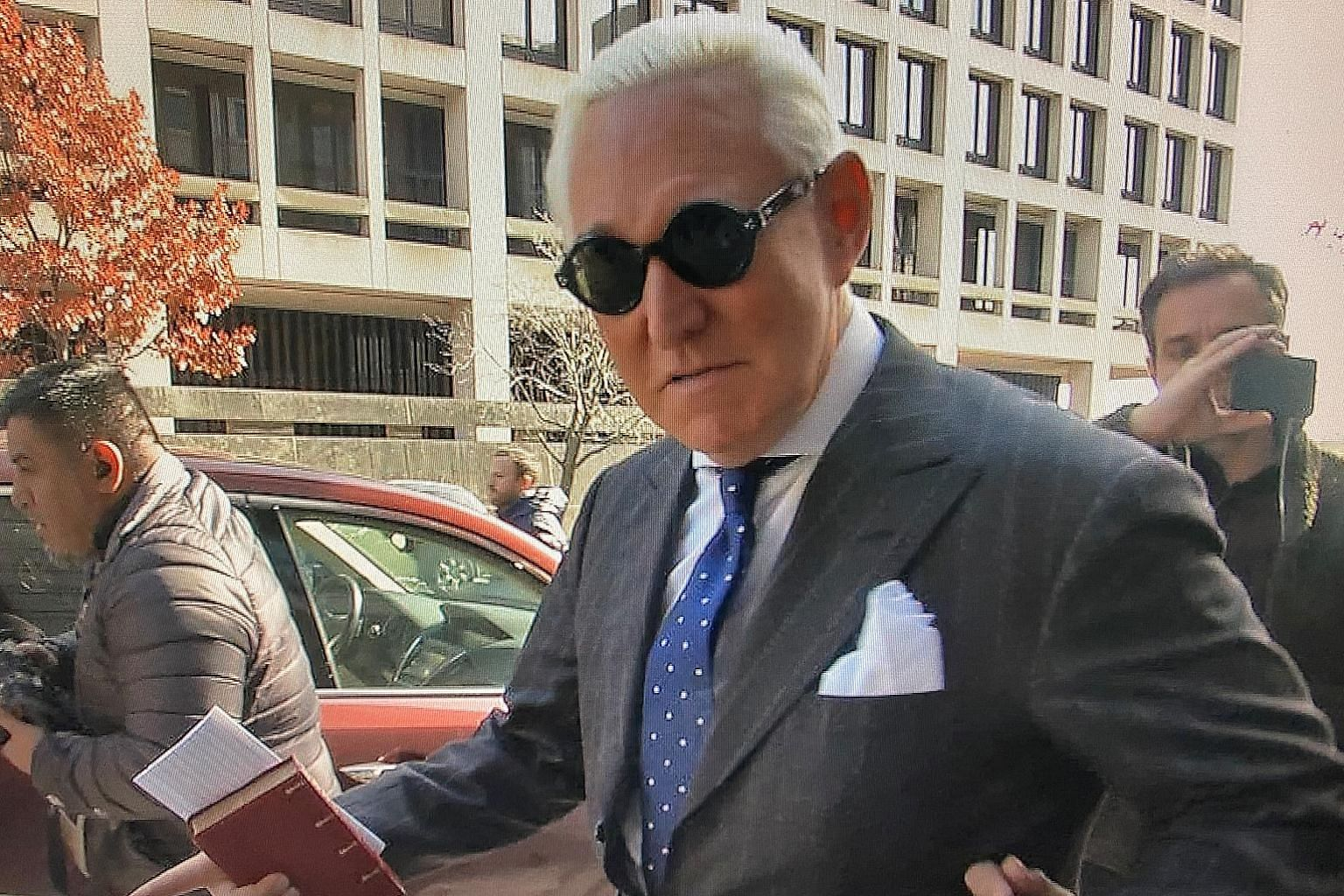 A screengrab from a video showing Roger Stone outside the US District Court in Washington on Friday after he was found guilty of lying to the US Congress, obstructing justice and witness tampering.