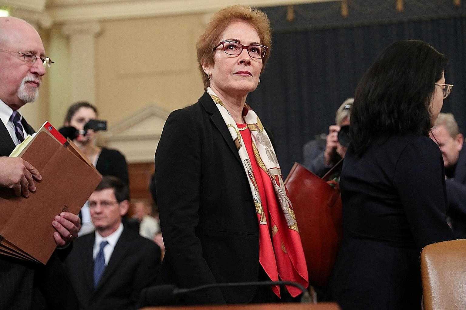 Former US ambassador to Ukraine Marie Yovanovitch leaving after her testimony on Friday as part of the US Congress' impeachment inquiry into President Donald Trump. Ms Yovanovitch described how Mr Trump's lawyer Rudy Giuliani worked with a corrupt Uk