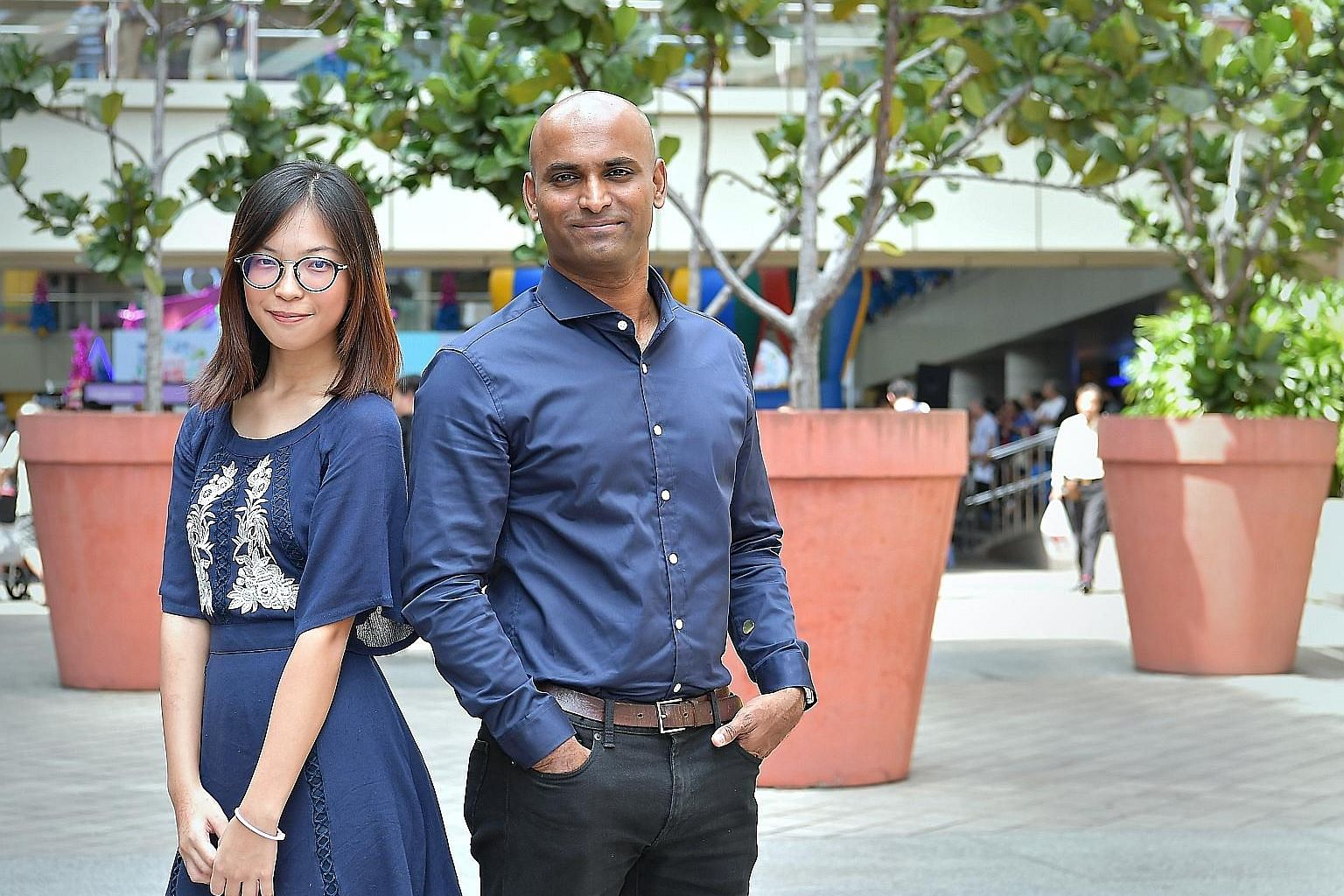 Ms Callie Ng and Mr P. Ramesh are among the 1,500 volunteers involved in the many programmes that Care Corner Singapore offers.