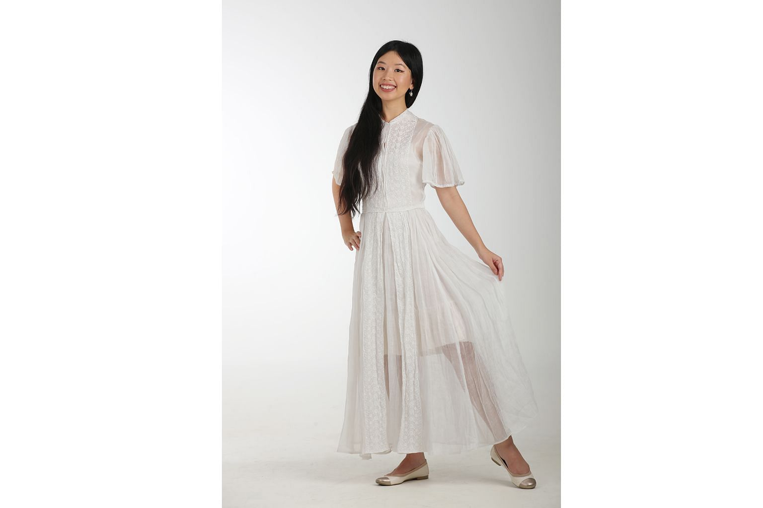 The Sunday Times writer Olivia Ho in her white silk organza gown, which she bought for $42.50 in a sale from United States-based Etsy store Simplicity Is Bliss.