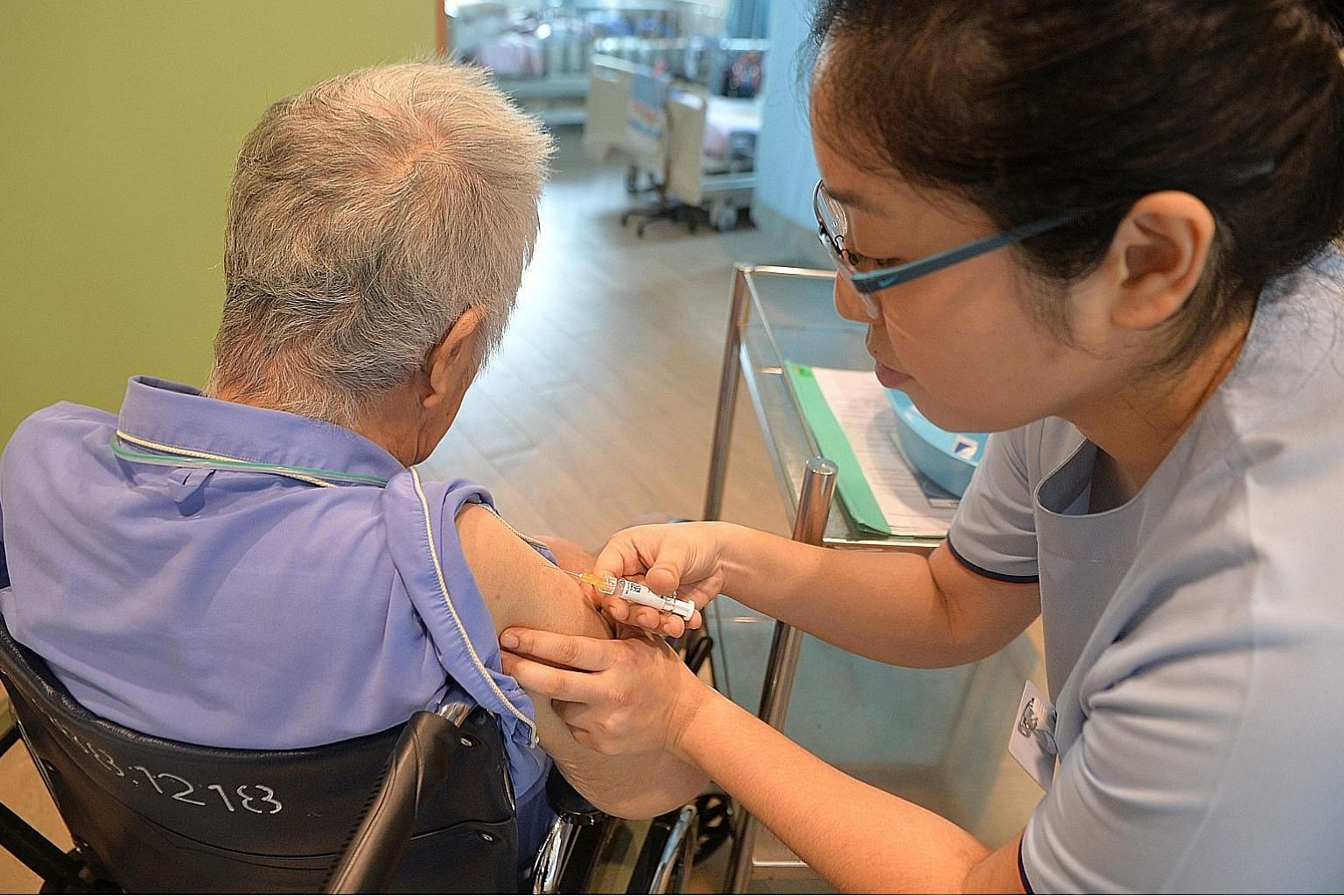 A nurse injecting the pneumococcal vaccine into an elderly resident at MWS Bethany Nursing Home - Choa Chu Kang. One dose of each of the PCV13 and PPSV23 vaccines is recommended to help keep the disease at bay.