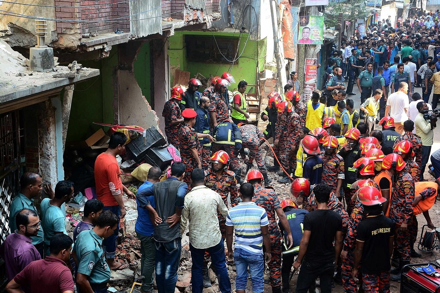 Rescue workers combing the site of a gas pipeline explosion in the Bangladesh port city of Chittagong yesterday. At least seven people were killed and eight injured in the blast, a police official said. The pipeline exploded in front of a five-storey