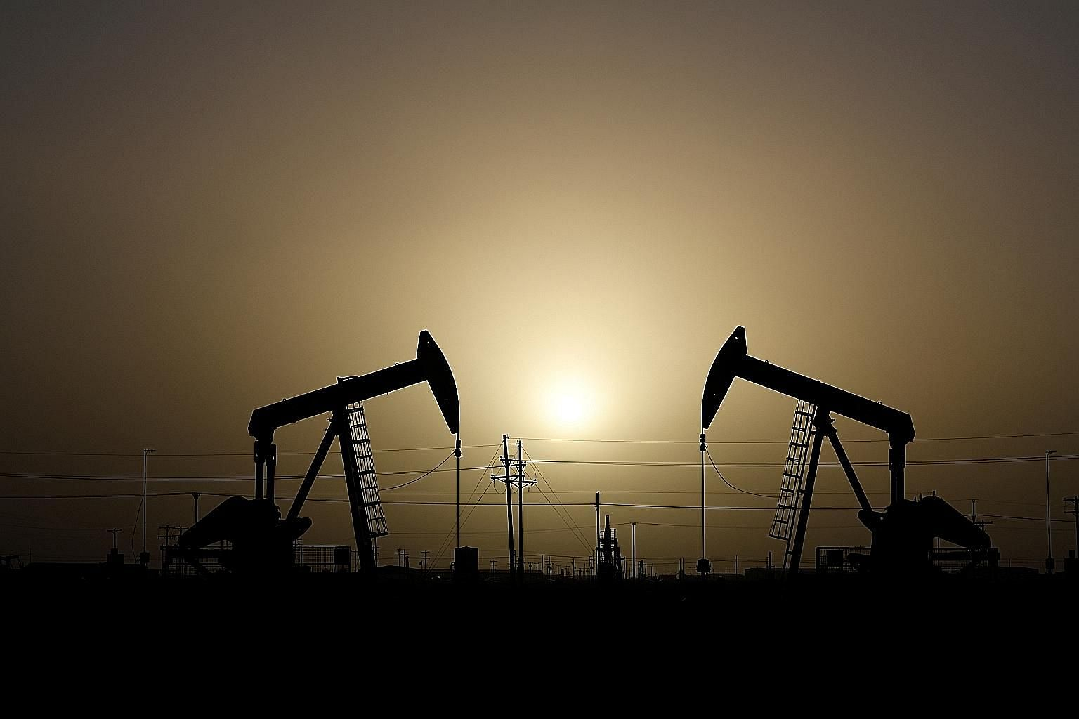 Pump jacks operating in Texas, where oil and gas products comprise the state's largest shipments to China, with sales falling 39 per cent.