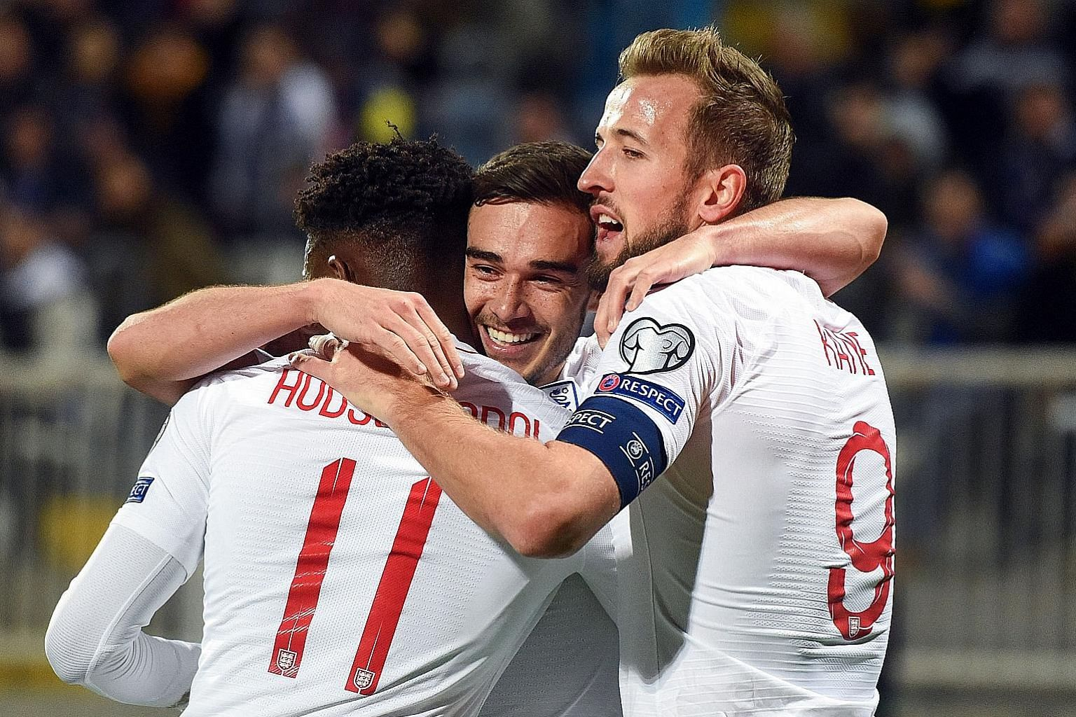 Harry Winks celebrating with Callum Hudson-Odoi and captain Harry Kane after opening accounts for England against Kosovo in Pristina. The Three Lions won 4-0 to complete their Euro 2020 qualifiers with seven wins and one loss - to the Czech Republic.
