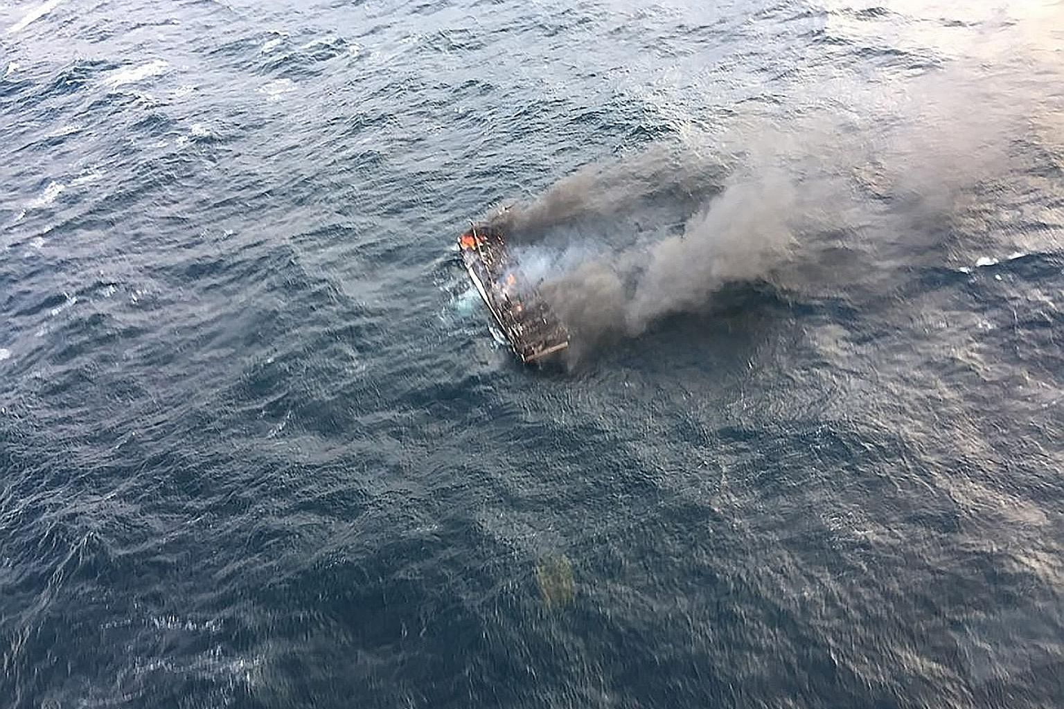 This photo taken yesterday and provided by the Korea Coast Guard shows a burning fishing boat in waters west of South Korea's southern island of Jeju. One fisherman was killed and 11 others reported missing after the boat caught fire, the local autho