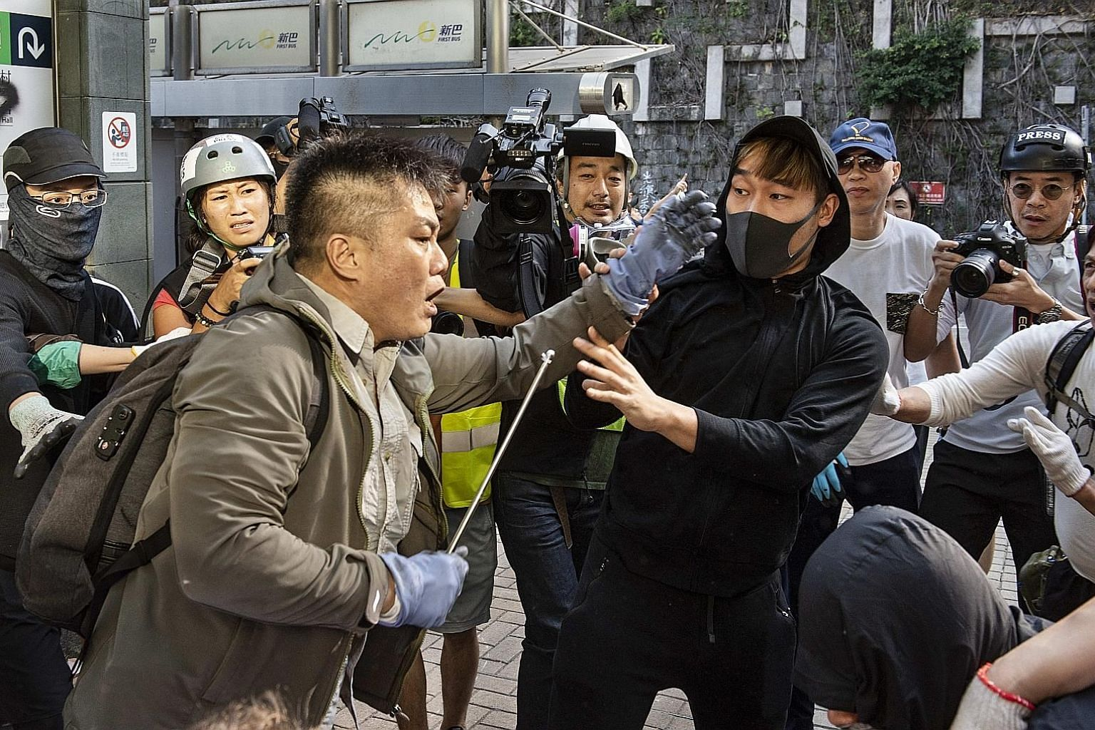A Hong Kong resident clashing with anti-government demonstrators at Hong Kong University during an anti-government protest last Saturday. The situation in the city is a nightmare for Chinese President Xi Jinping, who has made the restoration of China