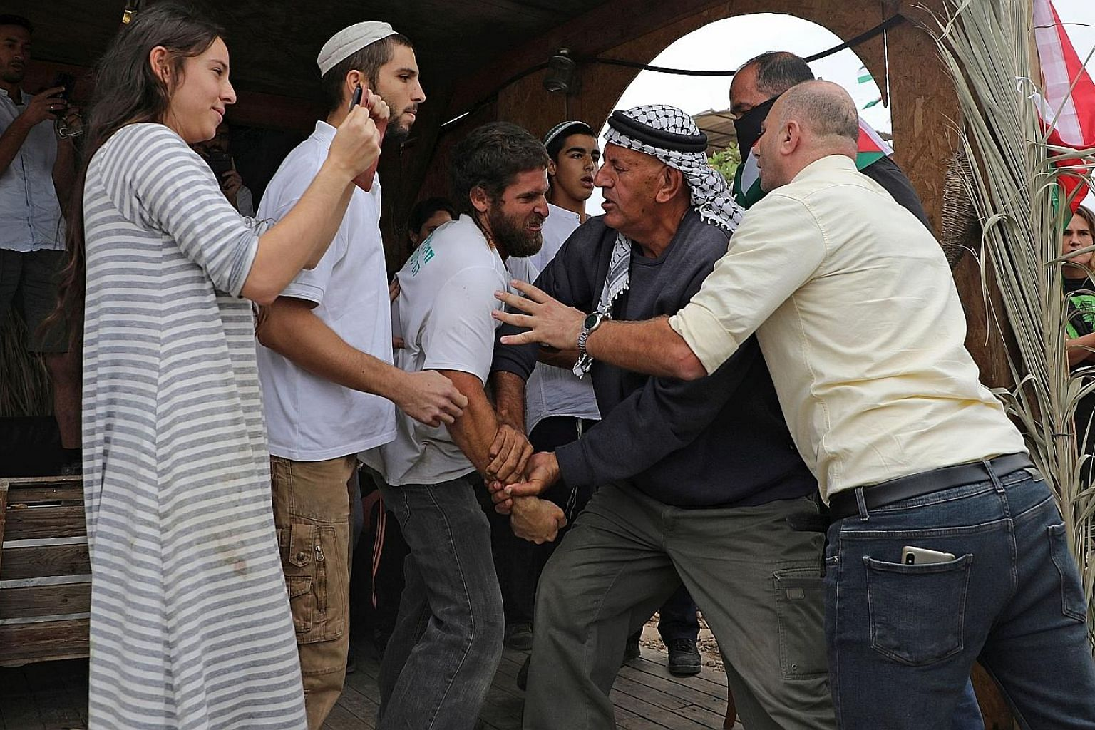 Israelis clashing with Palestinians on Oct 26 at a protest against the setting-up of an Israeli outpost in the Jordan Valley. PHOTO: AGENCE FRANCE-PRESSE