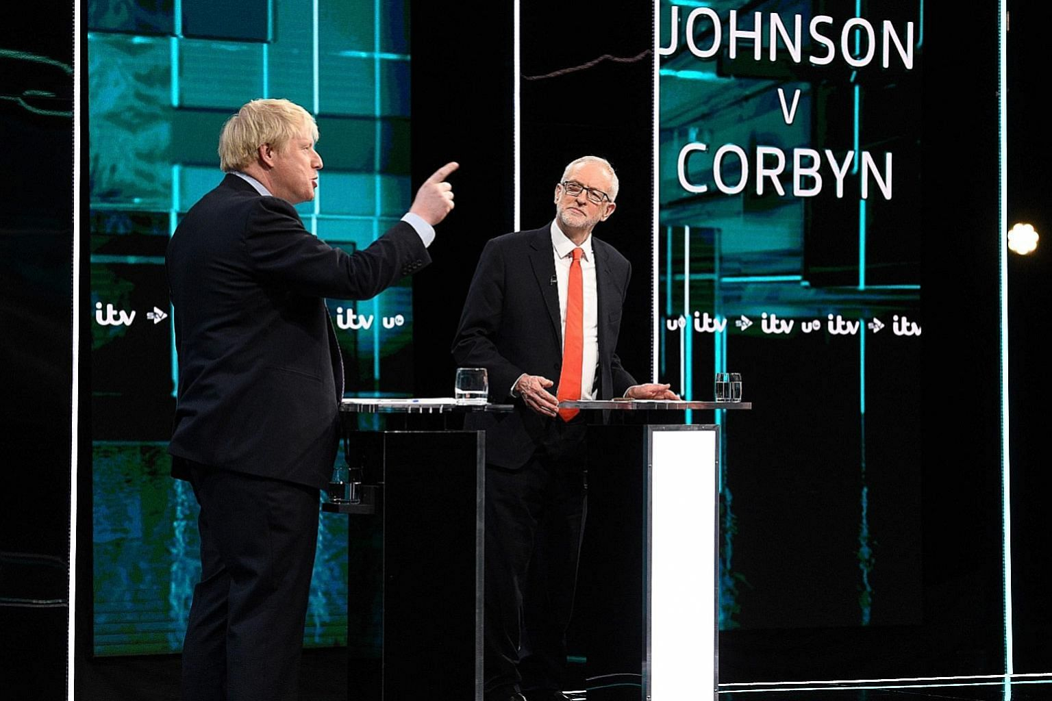 British Prime Minister Boris Johnson (left) and opposition Labour leader Jeremy Corbyn in the debate hosted by ITV on Tuesday. PHOTO: AGENCE FRANCE-PRESSE