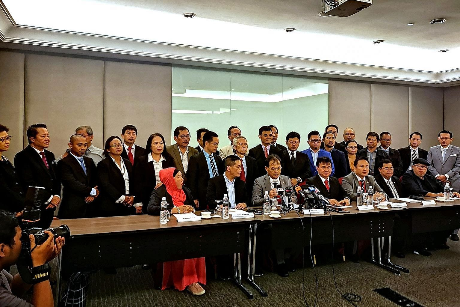 Parti Keadilan Rakyat Sarawak leaders with the state's party chairman and Works Minister Baru Bian (holding microphone) at a press conference in Kuala Lumpur yesterday.
