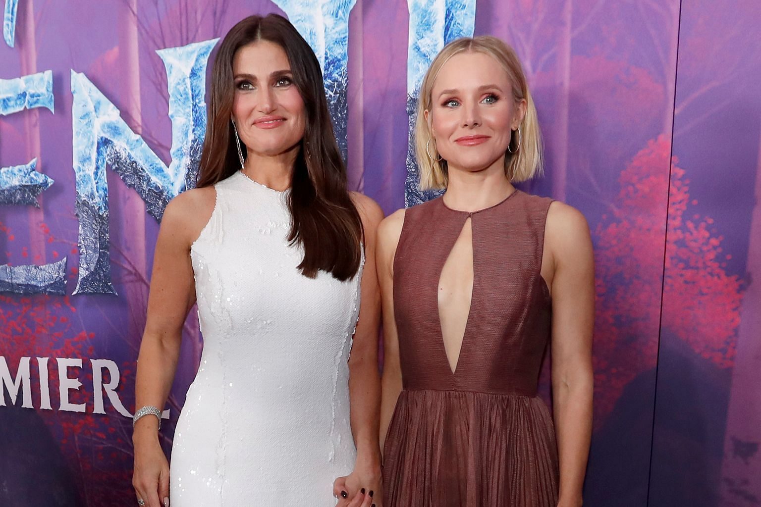 Frozen 2 (main picture) stars Idina Menzel (far left) and Kristen Bell, and is co-directed by Jennifer Lee (top) and Chris Buck (above).