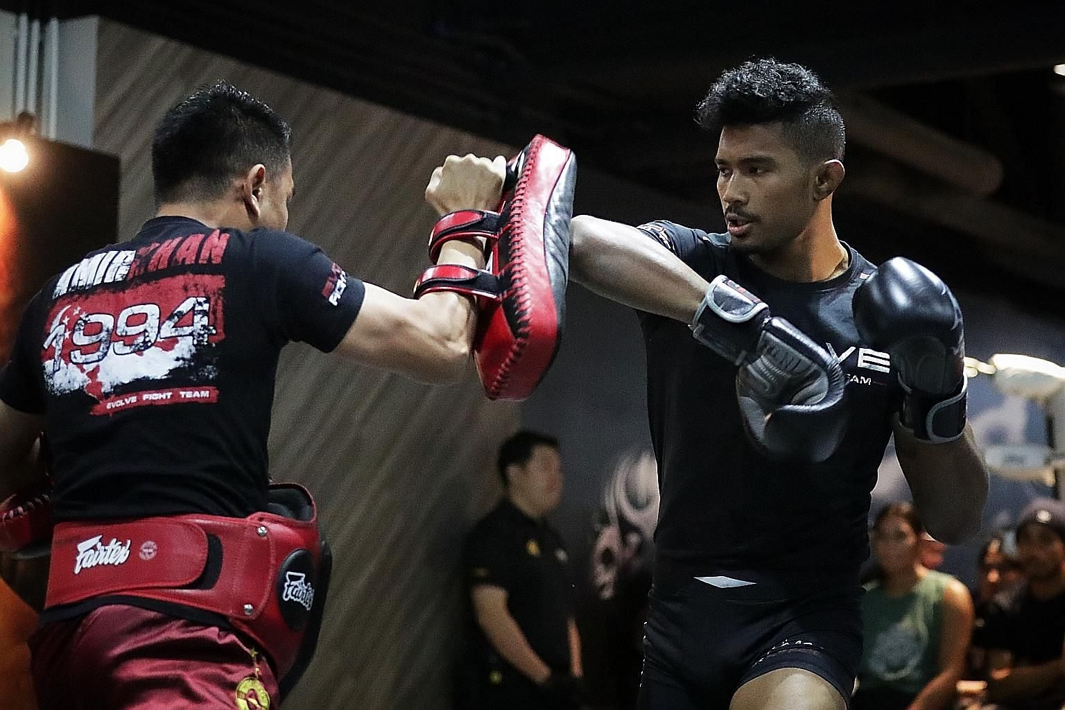 Singapore MMA fighter Amir Khan during the open workouts on Tuesday. He will fight Malaysia's Ev Ting in a lightweight bout, a co-main event at One Championship's Edge of Greatness event today. ST PHOTO: GIN TAY