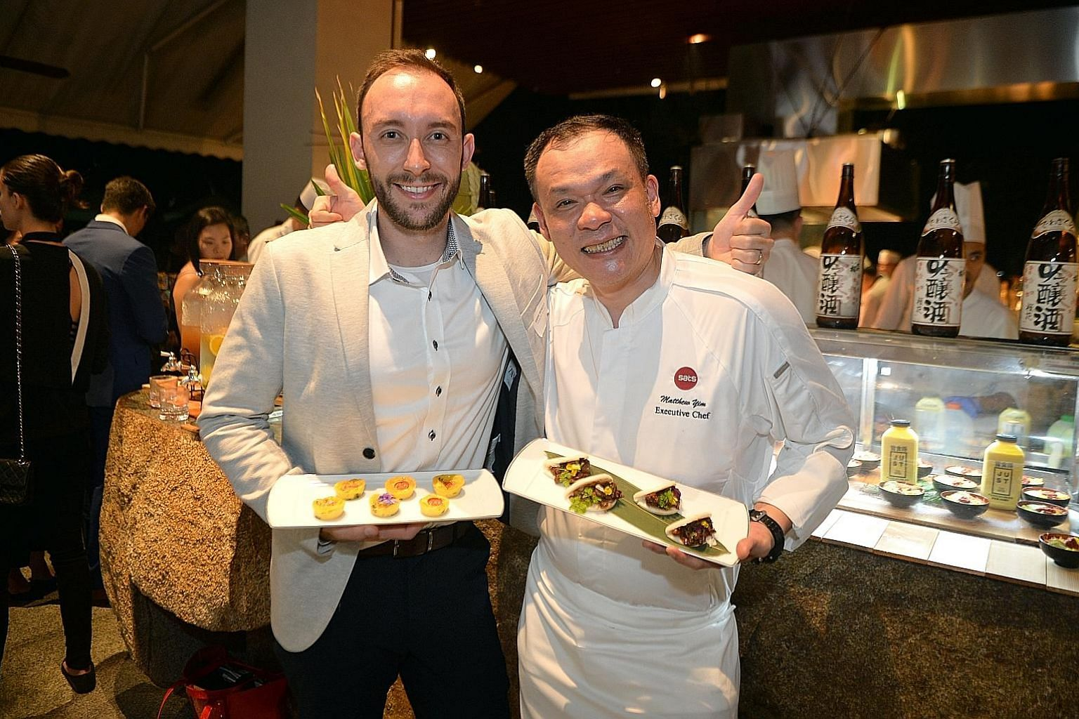 """Country Foods general manager Andre Menezes with a plate of Just egg frittata and Sats' executive chef Matthew Yim with """"char siew marinated Good Dot Proteiz on bun"""". The dishes were showcased on Thursday."""
