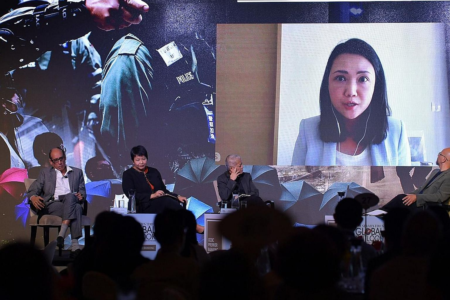 ST's Hong Kong correspondent Claire Huang, joining the panel at The Straits Times Global Outlook Forum via video conference yesterday. On stage were (from left) ST associate editor Vikram Khanna, OCBC Bank's head of treasury research and strategy Sel
