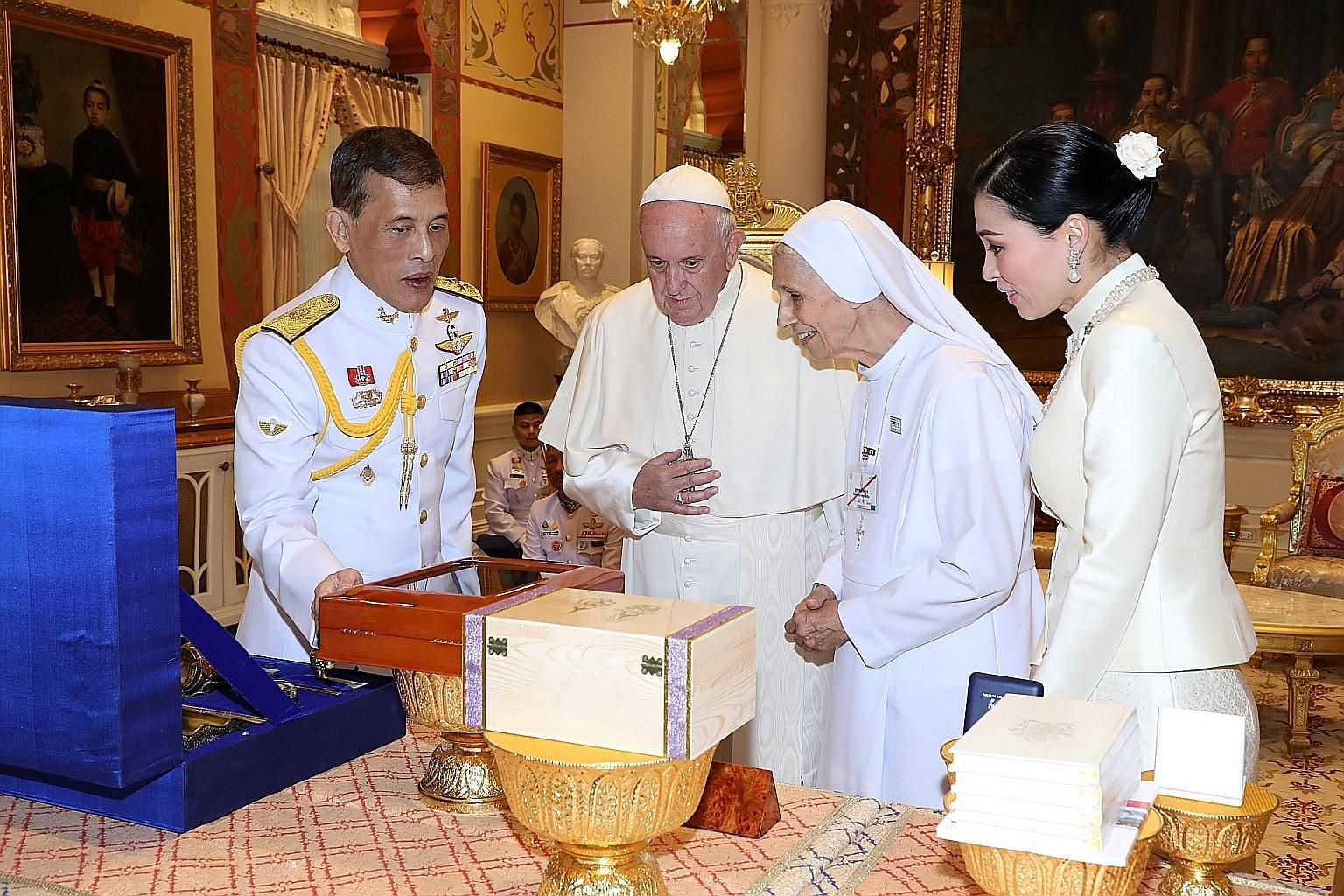 Pope Francis and his cousin, Sister Ana Rosa Sivori, exchanging gifts with Thai King Maha Vajiralongkorn and Queen Suthida during his visit to Bangkok on Thursday as part of his week-long Asia tour. Thai Catholics - a minority making up only 0.58 per