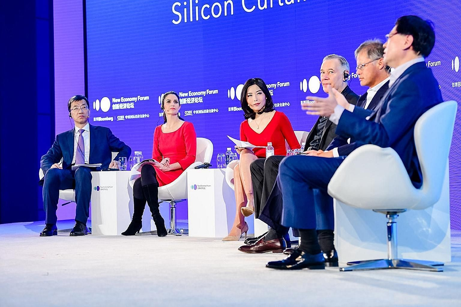 Lenovo chief executive Yang Yuanqing (far right) speaking at a panel discussion at the Bloomberg New Economy Forum in Beijing yesterday. With him were (from left) Mr Huai Jinpeng, executive vice-president of China Association for Science and Technolo