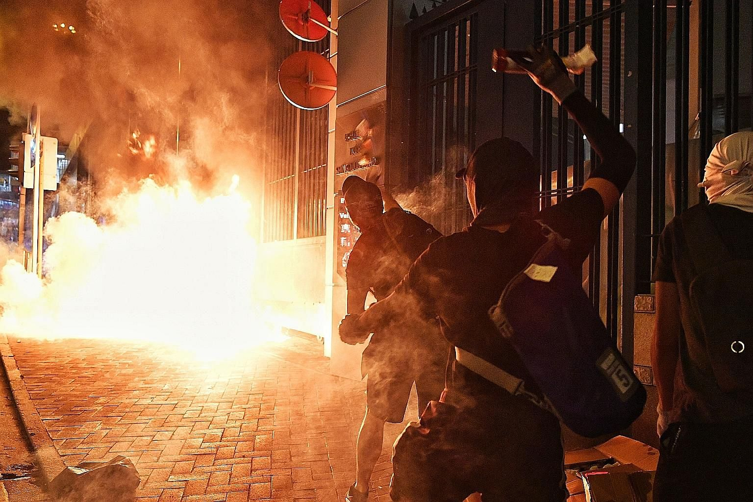 Protesters throwing Molotov cocktails at a police station in Tsuen Wan on Oct 2. The unrest in Hong Kong, sparked some five months ago by a legislative Bill that would have formalised extradition to mainland China, has since morphed into a far broade