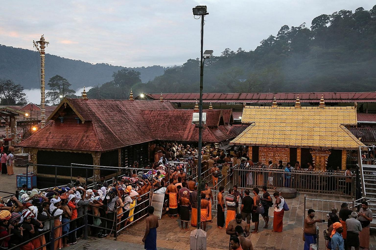 Hindu devotees at Sabarimala temple in Kerala in October last year. Following a Supreme Court verdict, women are now allowed to enter it, but the Kerala government has reverted to preventing women of childbearing age from doing so. PHOTO: REUTERS