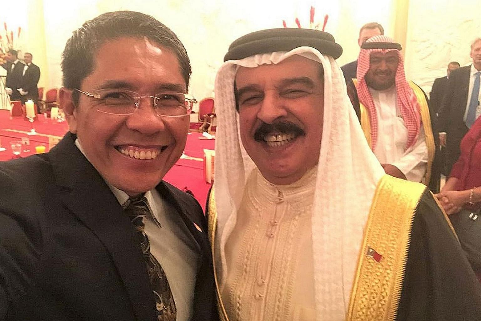 Senior Minister of State for Defence and Foreign Affairs Maliki Osman with Bahrain's King Hamad bin Isa Al Khalifa.
