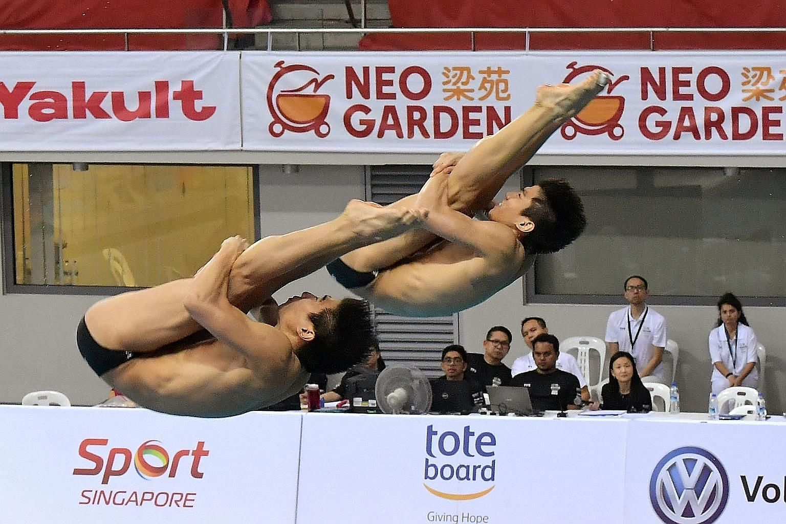 Singapore's Timothy (front) and Mark Lee showing good form on the final day of the Fina Diving Grand Prix Singapore at OCBC Aquatic Centre yesterday. They broke their synchronised 3m national record by more than five points to end fourth.